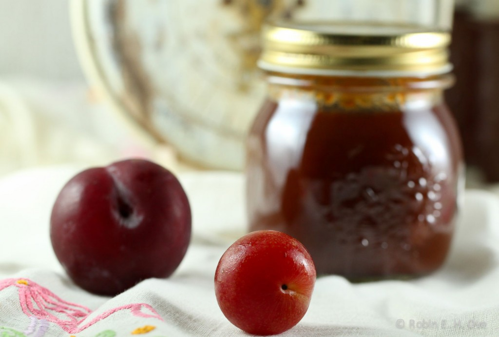 fresh plums and jarred preserves
