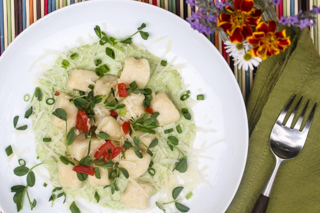 Fresh ricotta gnocchi with pea sauce