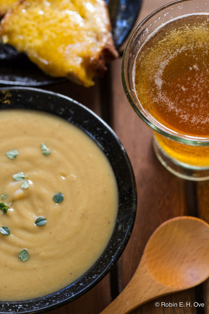Creamy cauliflower soup, cheese toast, and beer.