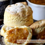 A biscuit, preserves and a cup of tea